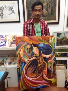 Artist/teacher Sokoun with one of his works